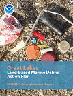 Cover page of accomplishments report, showing debris on a beach along Lake Erie