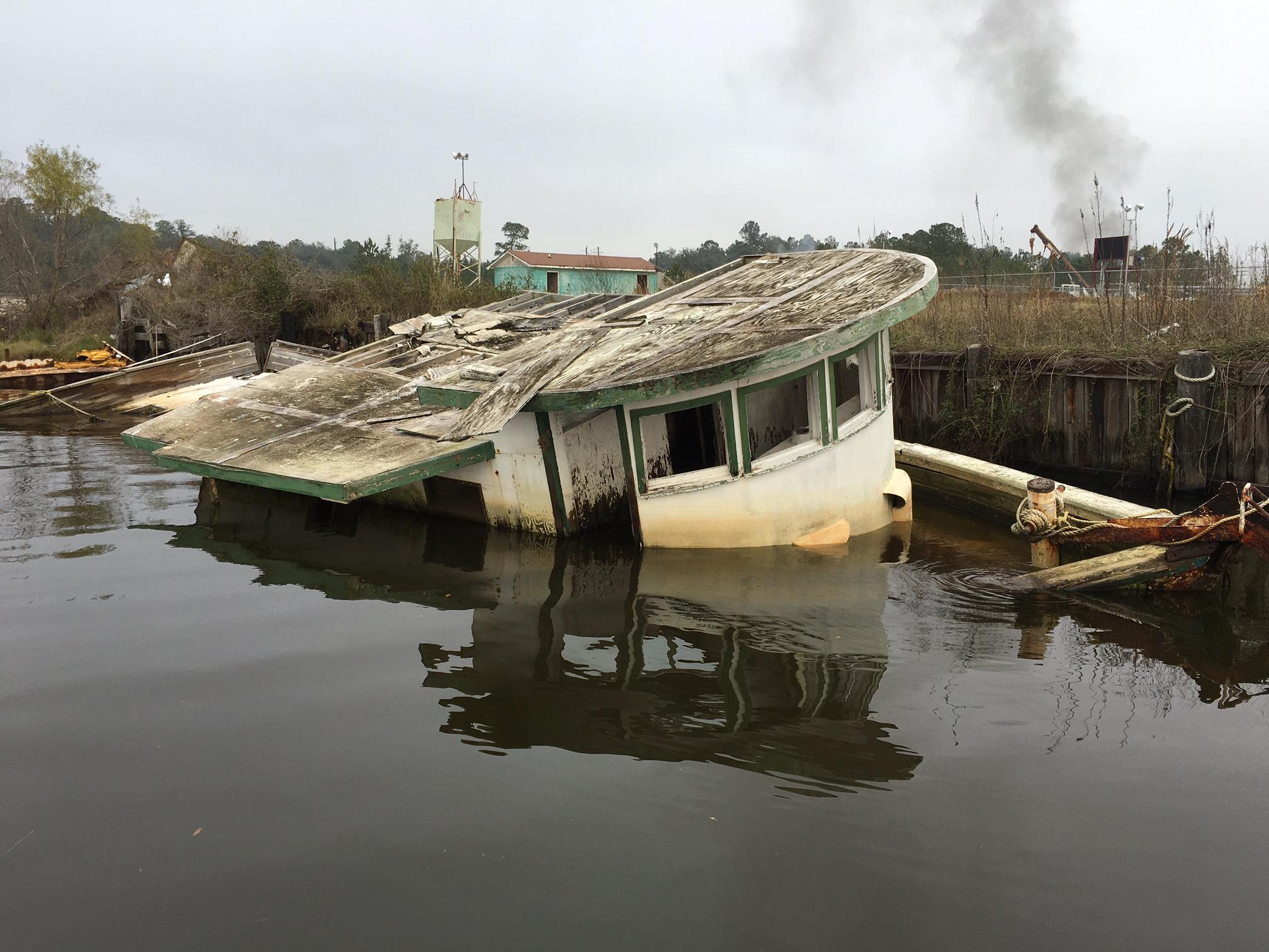 sunken shrimping boat next to port